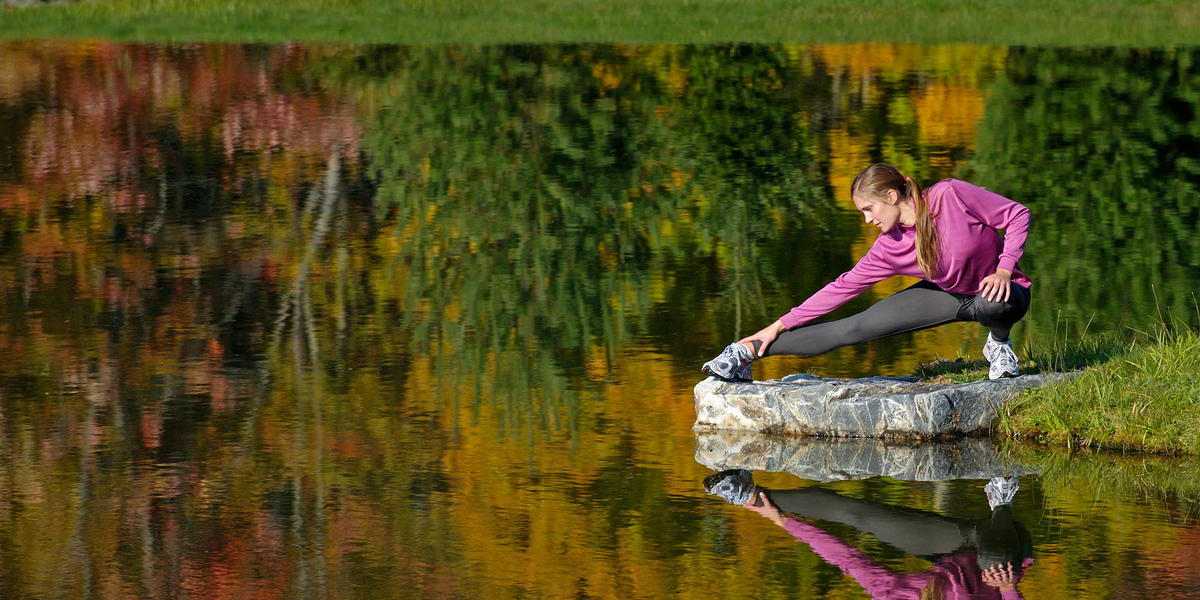 Woman Stretching by the Water