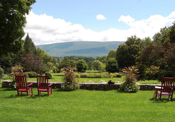 chairs on lawn overlooking mountains