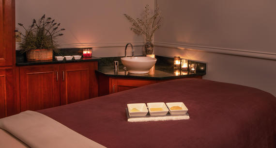 Massage bed and room with candles